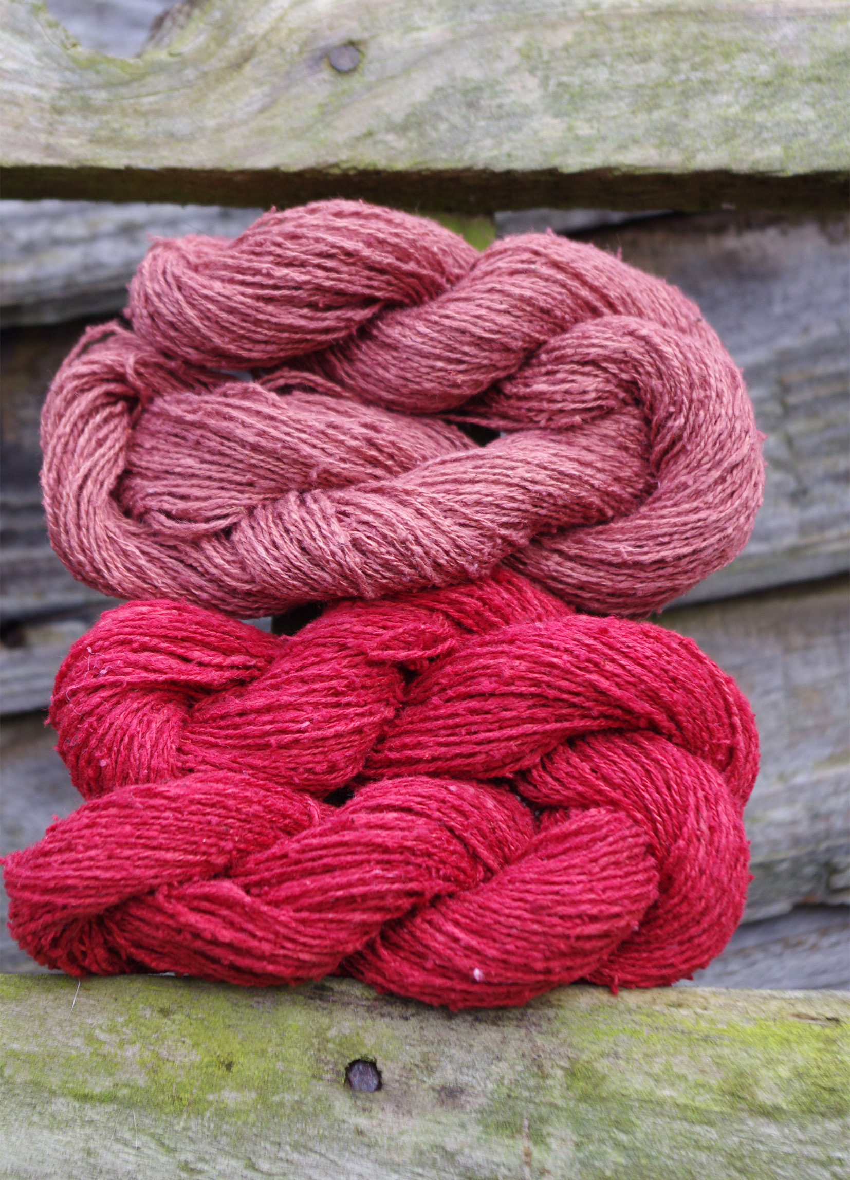 Two madder dyed silk skeins