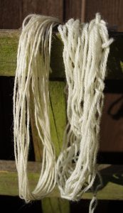 Both samples of yarn shown are the same shade of white