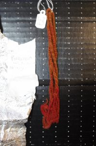 The same yarn from an indoor photo showing the side of the yarn that was facing the window which shows more fading