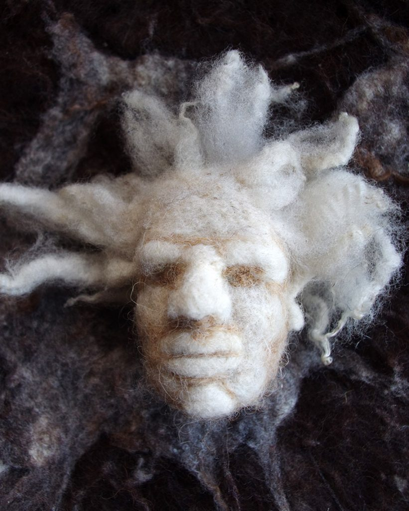 Needle felted head