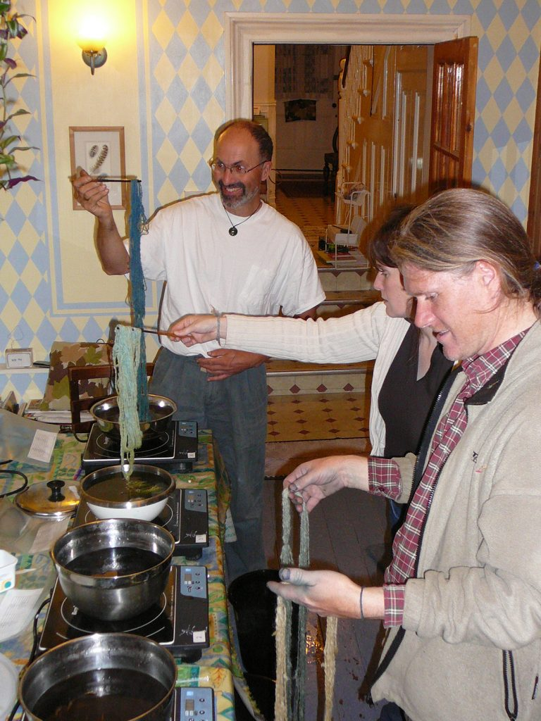 Brian Bond, Ashley Walker and Jenny Dye dyeing sample skeins of wool with indigo from Woad.
