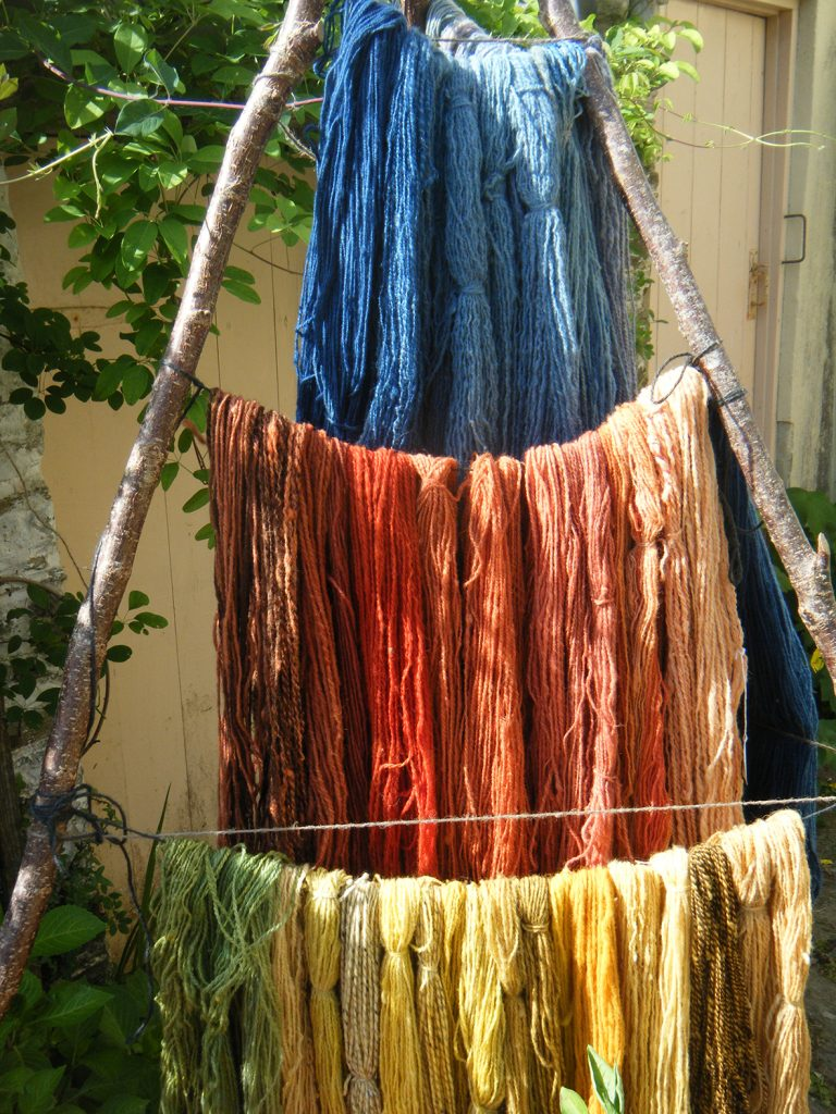Some of Brian's plant dyed handspun yarn in a rainbow of colours.